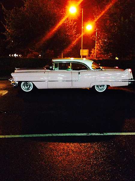 Pink Cadillac at night